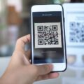 Women's,Hand,Uses,A,Mobile,Phone,Application,To,Scan,Qr